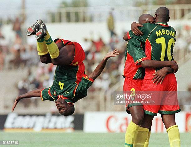 Cameroon's players Tobie Mimboe Pierre Wome and Patrick Mboma celebrate during their Group A match of the African Nations Cup match 11 February in...