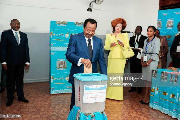 Cameroon's President and head of Cameroon People's Democratic Movement Paul Biya and his wife Chantal Biya arrive to cast their votes at a polling...
