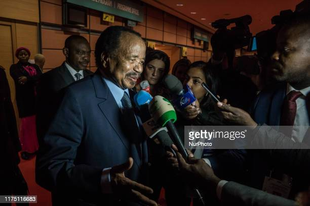 Cameroon's President Paul Biya answers journalists' questions during the fundraising day at the sixth World Fund Conference in Lyon, France, on 10...