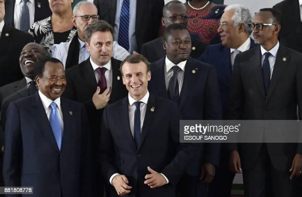 Cameroon's President Paul Biya speaks with French President Emmanuel Macron next to Togo's President Faure Gnassingbe Luxembourg's President Xavier...