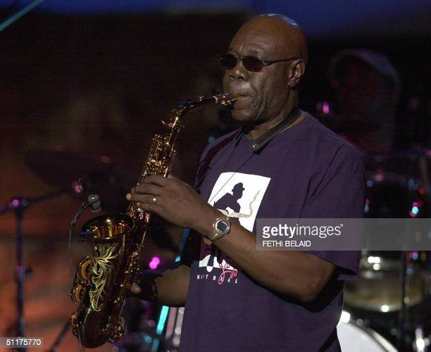 Cameroon's saxophonist Manu Dibango performs during the International Carthage festival late 15 August 2004 at the Roman theatre in Carthage near...