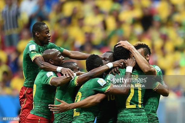 Cameroon's squad celebrates after scoring a goal during the Group A football match between Cameroon and Brazil at the Mane Garrincha National Stadium...