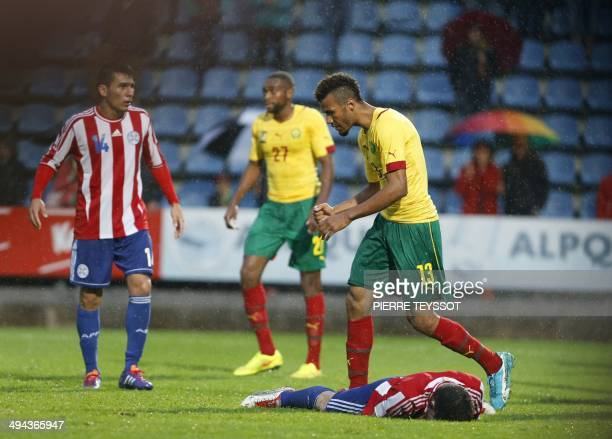 Cameroon's striker Eric ChoupoMoting reacts after scoring during the FIFA World Cup 2014 friendly football match between Cameroon and Paraguay at the...