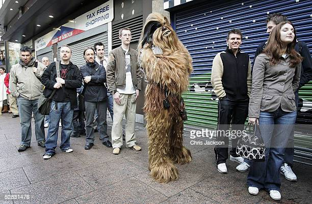 Camerun Wolf Dahl queues in his Chewbacca suit outside the Empire cinema for the first ever screening of the entire sixfilm Star Wars saga in...