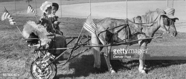 Cami Costa above drives her brother and the family dog in Broomfield Days pa­rade They are children of Mr and Mrs Ben Costa 14703 Fenton St At left...