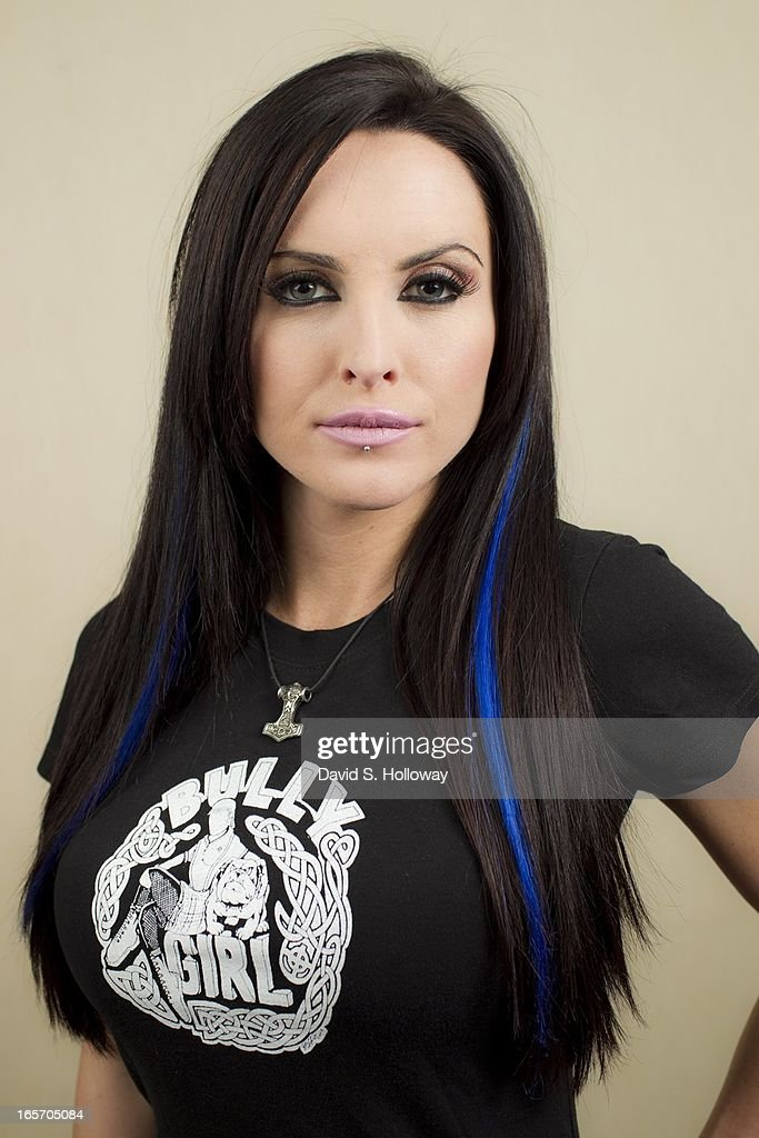 Cami Lynn, girlfriend of National Socialist Movement Commander Jeff Schoep and fetish model models t-shirts sold by the NSM in Detroit, Michigan on December 28, 2011.