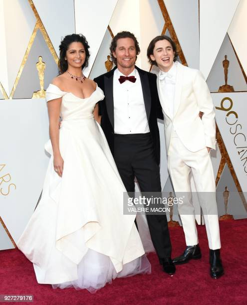 TOPSHOT Camila Alves Actor Matthew McConaughey and US actor Timothee Chalamet arrive for the 90th Annual Academy Awards on March 4 in Hollywood...