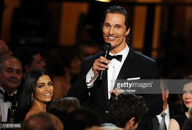 Camila Alves and actor Matthew McConaughey speak in the audience at the 39th AFI Life Achievement Award honoring Morgan Freeman held at Sony Pictures...