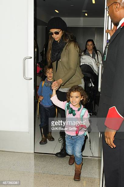 Camila Alves and her childre Vida Alves McConaughey and Levi Alves McConaughey are seen arriving at LAX airport on December 16 2013 in Los Angeles...