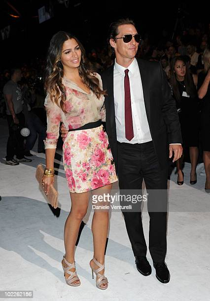 Camila Alves and Matthew McConaughey attend the Dolce Gabbana Milan Menswear Spring/Summer 2011 show on June 19 2010 in Milan Italy