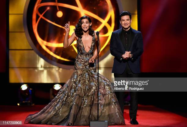 Camila Banus and host Mario Lopez speak onstage at the 46th annual Daytime Emmy Awards at Pasadena Civic Center on May 05 2019 in Pasadena California