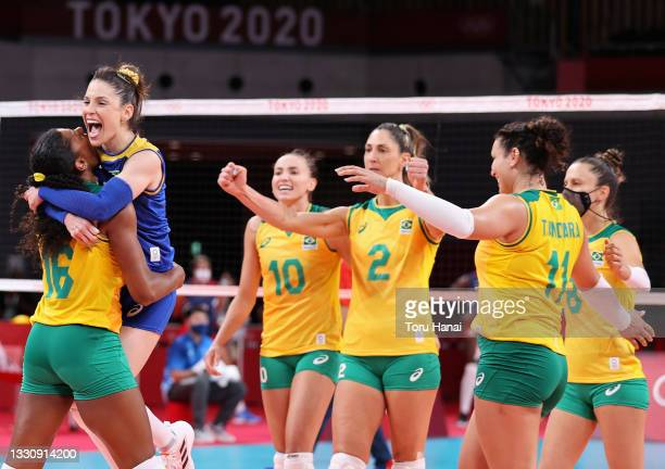 Camila Brait and Fernanda Rodrigues of Team Brazil react with team mates against Team Dominican Republic during the Women's Preliminary - Pool A...