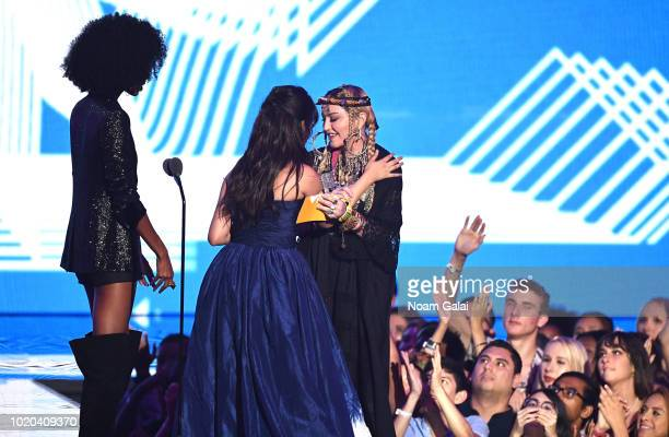 Camila Cabello accepts the award for Video of the Year from Madonna onstage during the 2018 MTV Video Music Awards at Radio City Music Hall on August...