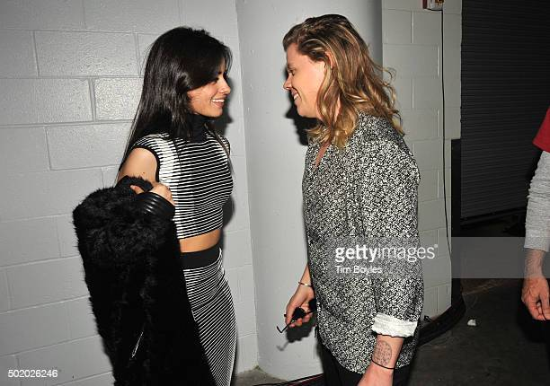 Camila Cabello and Conrad Sewell pose backstage during 93.3 FLZ's Jingle Ball 2015 Presented by Capital One at Amalie Arena on December 19, 2015 in...