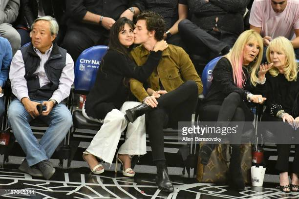 Camila Cabello and Shawn Mendes attend a basketball game between the Los Angeles Clippers and the Toronto Raptors at Staples Center on November 11...