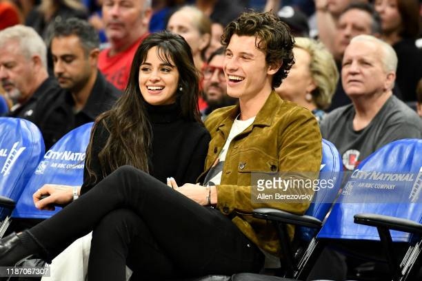 Camila Cabello and Shawn Mendes attend a basketball game between the Los Angeles Clippers and the Toronto Raptors at Staples Center on November 11,...