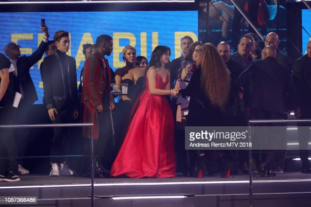 Camila Cabello greets Janet Jackson after winning The Global Icon Award on stage during the MTV EMAs 2018 at Bilbao Exhibition Centre on November 4...
