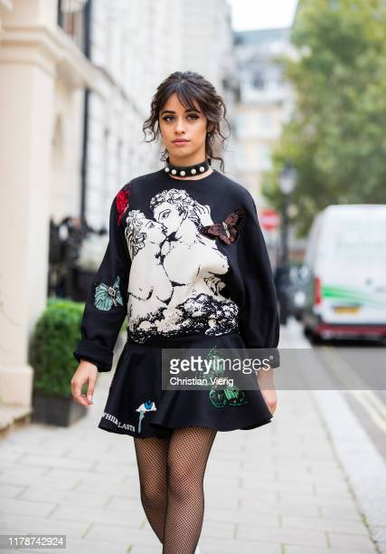 Camila Cabello is seen wearing total look Valentino bag dress with graphic print sheer tights on October 03 2019 in London England