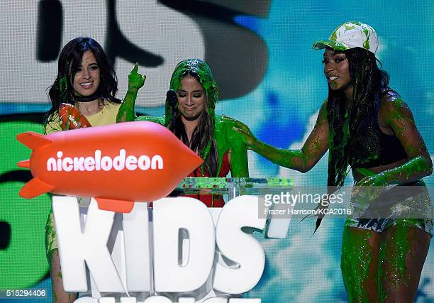 Camila Cabello Lauren Jauregui and Normani Hamilton of Fifth Harmony get slimed onstage during Nickelodeon's 2016 Kids' Choice Awards at The Forum on...