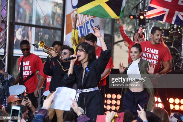 Camila Cabello performs onstage showing her support for DACA while wearing an ACLU ribbon on NBC's 'Today' at Rockefeller Plaza on September 29 2017...