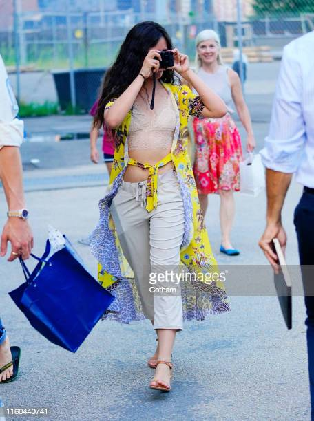 Camila Cabello takes a photo while out with Shawn Mendes on August 8 2019 in New York City