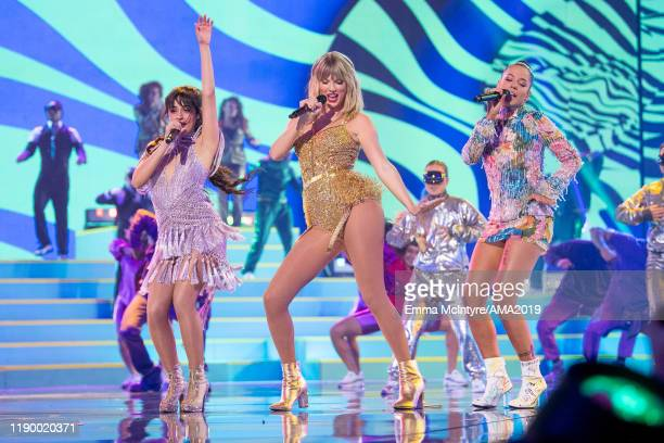 Camila Cabello Taylor Swift and Halsey perform onstage at the 2019 American Music Awards at Microsoft Theater on November 24 2019 in Los Angeles...