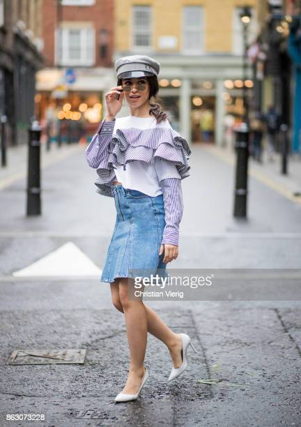 Camila Cabello wearing denim skirt Holzweiler Dry Clean Only top military hat Ruslan Baginskiy Gianvito Rossi pumps is seen on October 19 2017 in...
