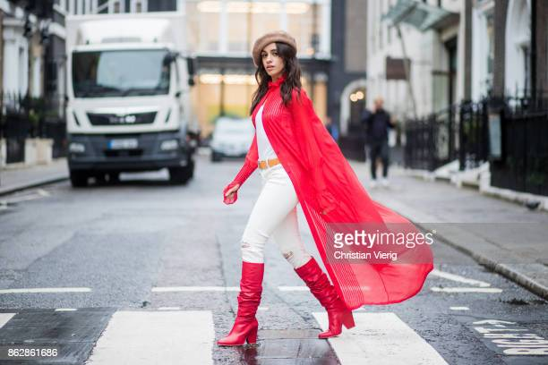 Camila Cabello wearing red kimono Ulyana Sergeenko white pants brown beret red Stuart Weitzman boots is seen on October 18 2017 in London England