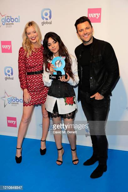 Camila Cabello winner of Best Female Award poses with Laura Whitmore and Mark Wright in the Winners Room during The Global Awards 2020 at the Eventim...