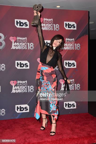 Camila Cabello, winner of the Fangirls Award, poses in the press room during the 2018 iHeartRadio Music Awards which broadcasted live on TBS, TNT,...