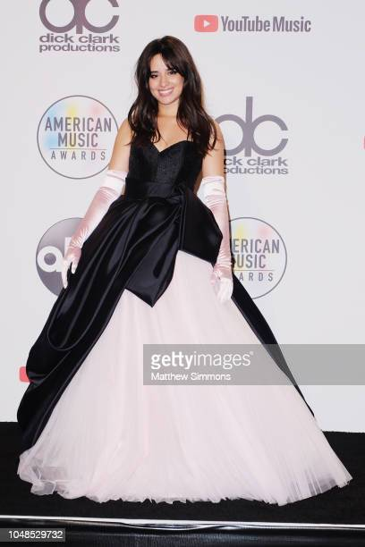 Camila Cabello winner of the New Artist of the Year presented by Capital One Savor Card award poses in the press room during the 2018 American Music...