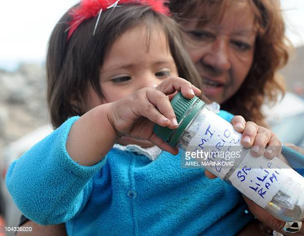 Camila Campillay granddaughter of Mario Gomez one of the 33 miners trapped receives a capsule with messages from him on September 21 2010 at the San...