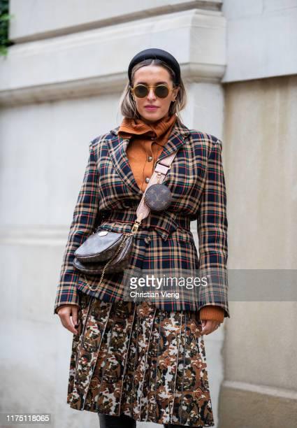 Camila Carril seen wearing Louis Vuitton bag plaid blazer skirt with print outside Erdem during London Fashion Week September 2019 on September 16...