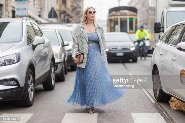 Camila Carril wearing a blue sheer dress outside Emilio Pucci during Milan Fashion Week Fall/Winter 2017/18 on February 23 2017 in Milan Italy
