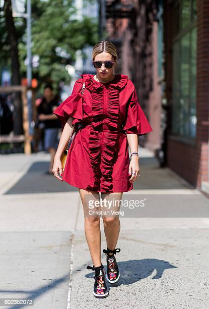 Camila Carril wearing a red dress outside Tibi on September 10 2016 in New York City