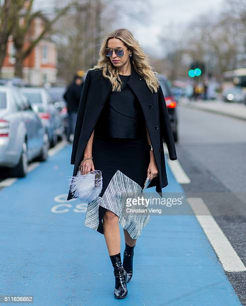 Camila Carril wearing Dior boots The Outnet top Jimmy Choo bag and Roland Mouret seen outside Topshop during London Fashion Week Autumn/Winter...
