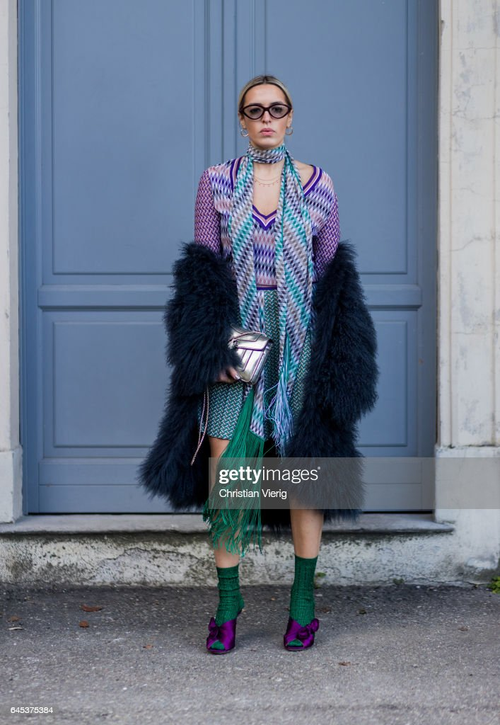 Camila Carril wearing Missoni dress,navy fur coat, green socks, purple heels outside Missoni during Milan Fashion Week Fall/Winter 2017/18 on February 25, 2017 in Milan, Italy.