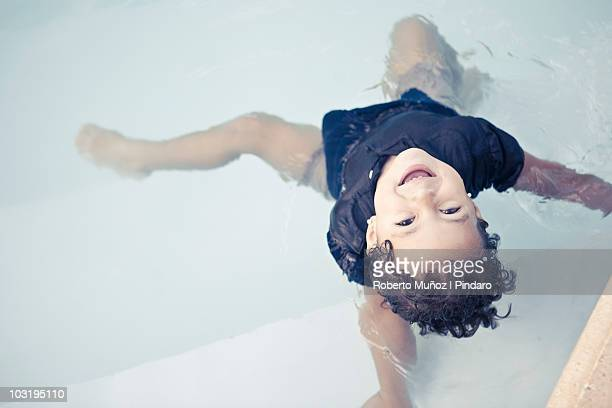 camila clothed at pool - roberto ricciuti foto e immagini stock