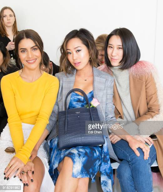 Camila Coelho Aimee Song and Eva Chen attend the Michael Kors Collection Fall 2018 Runway Show at the Vivian Beaumont Theatre on February 14 2018 in...