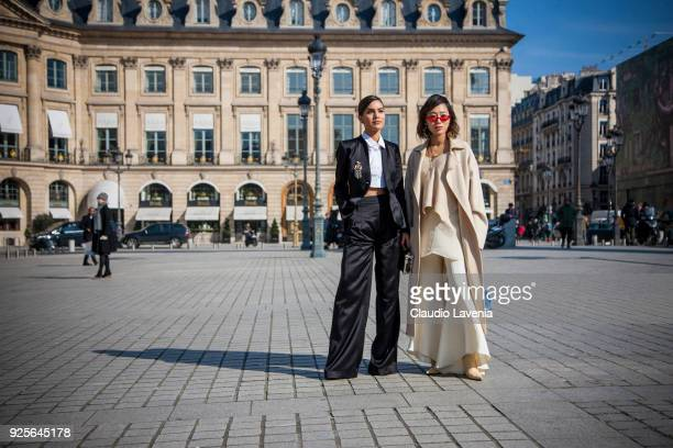 Camila Coelho and Aimee Song are seen in the streets of Paris before the Lanvin show during Paris Fashion Week Womenswear Fall/Winter 2018/2019 on...