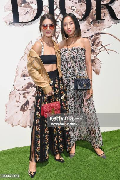 Camila Coelho and Aimee Song attend the Christian Dior Haute Couture Fall/Winter 20172018 show as part of Haute Couture Paris Fashion Week on July 3...