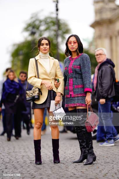 Camila Coelho and Aimee Song outside Chanel during Paris Fashion Week Womenswear Spring/Summer 2019 on October 2 2018 in Paris France