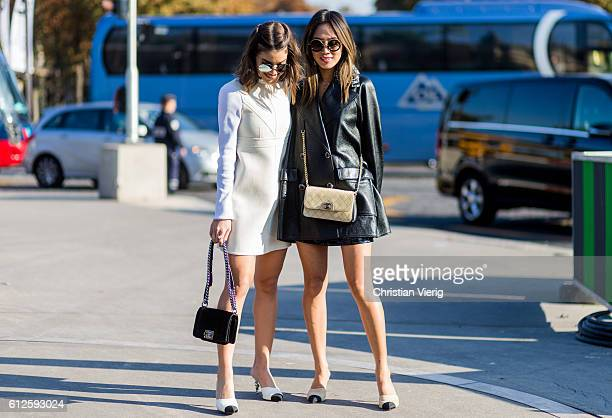 Camila Coelho and Aimee Song outside Chanel on October 4 2016 in Paris France