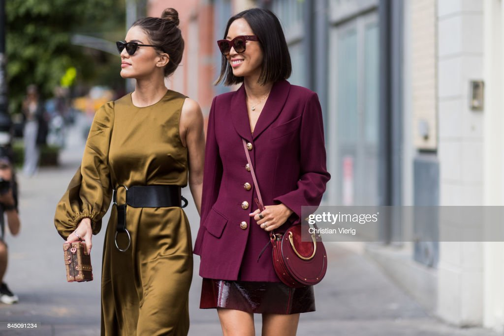Camila Coelho and Aimee Song wearing bordeaux blazer jacket, skirt, boots seen in the streets of Manhattan outside Tibi during New York Fashion Week on September 9, 2017 in New York City.