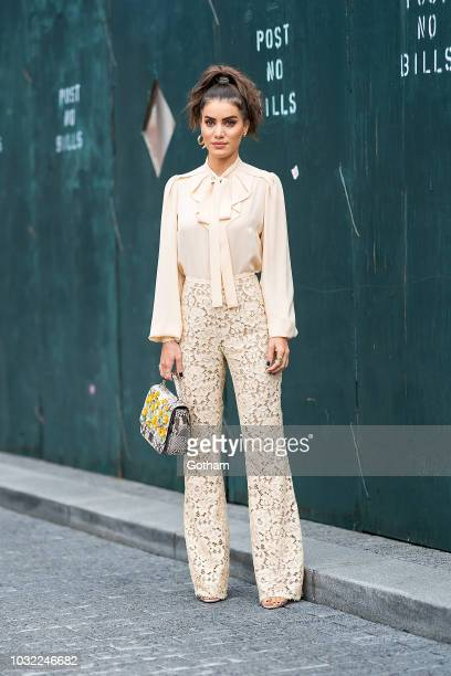 Camila Coelho attends the Michael Kors fashion show during New York Fashion Week The Shows at Pier 17 in the South Street Seaport on September 12...