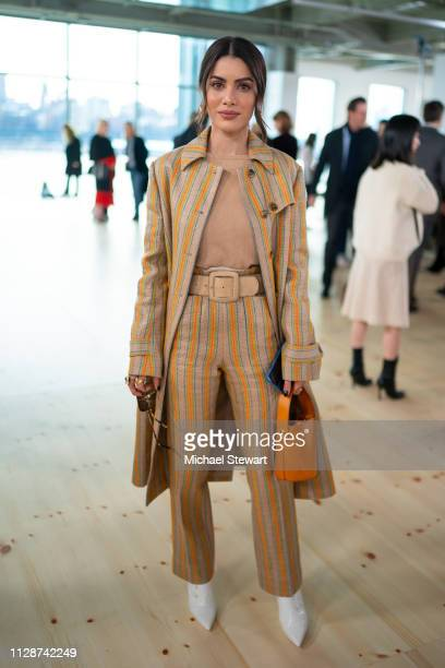 Camila Coelho attends the Tory Burch Fall Winter 2019 Fashion Show at Pier 17 on February 10 2019 in New York City