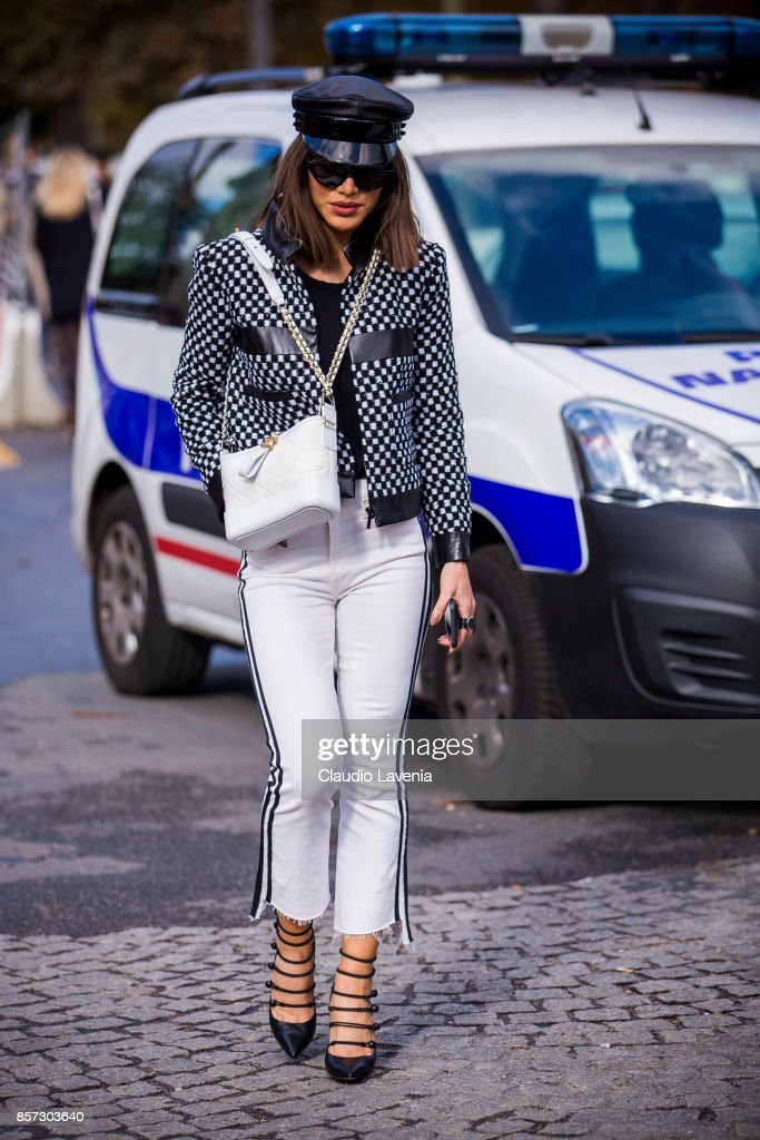 Camila Coelho is seen in the streets of Paris, after the Chanel show during Paris Fashion Week Womenswear SS18 on October 3, 2017 in Paris, France.