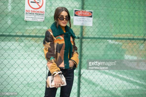 Camila Coelho is seen on the street during New York Fashion Week AW19 wearing Coach on February 12 2019 in New York City