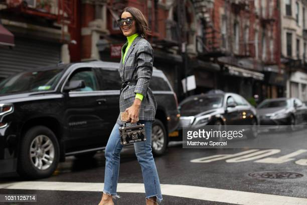 Camila Coelho is seen on the street during New York Fashion Week SS19 wearing Phillip Lim on September 10 2018 in New York City