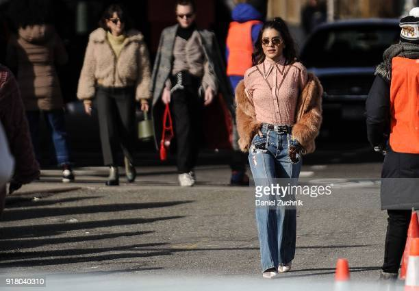 Camila Coelho is seen outside the Coach show during New York Fashion Week Women's A/W 2018 on February 13 2018 in New York City